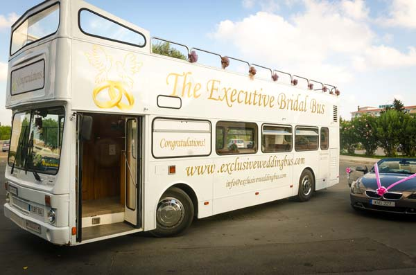 Ivory open topped double decker bus