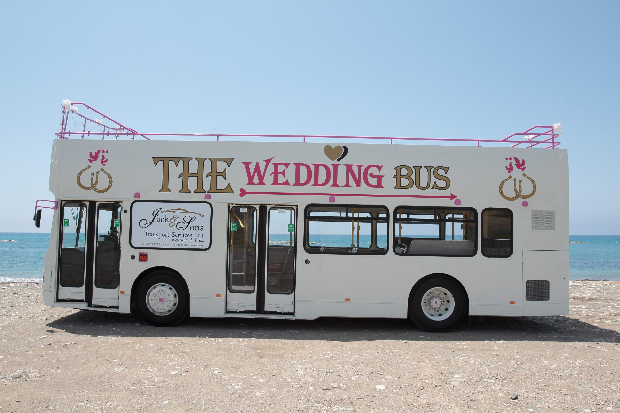 White open topped double decker bus
